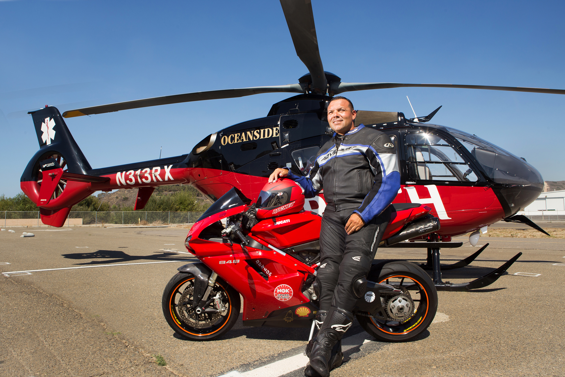 Brian Cortez in front of the REACH Oceanside helicopter that transported him to the hospital.