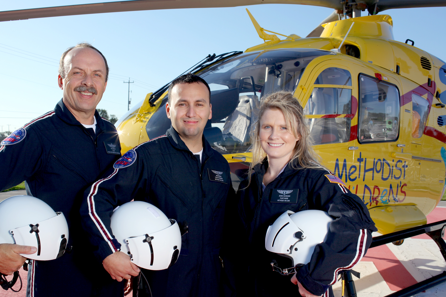 Leia's transport team from Methodist AirCare included Pilot Bill Soeth, left, and Flight Nurse Jessica Schroder, right, acting as Safety Officer.